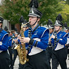 Members of the Carthage High School Band make their way down the parade route on Saturday at the 50th Annual Maple Leaf Parade in Carthage.<br /> Globe | Laurie Sisk
