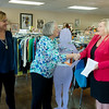 Globe/Roger Nomer <br /> (from left) Louise Secker, development director for Lafayette House, and Alison Malinowki Sunday, executive director of Lafayette House, accept a check for $5,000 from the Verizon HopeLine Grant from Sheryl Blakeley, goverment account executive for Verizon, on Monday at the Second Chances Lafayette House Resale Shop. The donation is in honor of Domestic Violence Awareness Month. The money will go to helping sponsor a paid internship at the store, which functions as an employment training site.