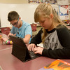 Globe/Roger Nomer<br /> Zachary Cook, eighth grade, and Brianna Scholl, sixth grade, work with technology on Tuesday at South Middle School.