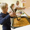 Globe/Roger Nomer<br /> (from left) Judy Hardy, Nancy Erwin, co-pastor, and Jerry Smallwood serve vegetable soup and chili on Friday during the annual fundraiser at First Gospel Workers Church.