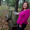 Globe/Roger Nomer<br /> Lisa L. Martin poses next to a grave marker at the Peace Church Cemetery on Wednesday morning.
