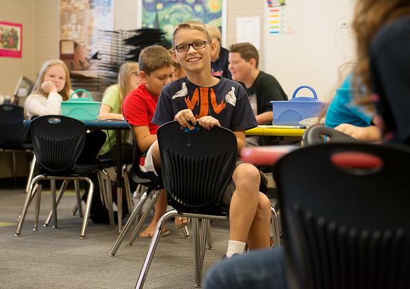 Globe/Roger Nomer<br /> Parker Williamson smiles as he greets classmate Noah Burnison on Tuesday at Kelsey Norman Elementary.