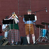Some of he members of the seven-piece German band Mach Schell Blaskapelle entertain guests at Oktoberfest on Saturday at JB's outdoor venue.<br /> Globe | Laurie Sisk
