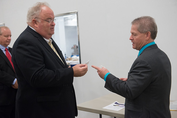 Globe/Roger Nomer<br /> Ron Nowlin, vice president of defense and aerospace for EaglePicher Technologies, shows Congressman Billy Long a battery to be made at the company's new plant during a tour on Friday.