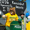 Members of the Sigma Pi fraternity at Missouri Southern ride their election-themed float during the Missouri Southern Homecoming Parade on Saturday at MSSU.<br /> Globe | Laurie Sisk