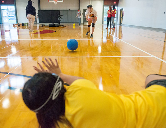 Globe/Roger Nomer<br /> Brittany Shires, a Pittsburg State senior from Tonganoxie, practices Goalball with a roll to Chelsea Mongomery, a senior from Pittsburg, on Tuesday at the PSU Student Recreation Center.