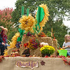 Carthage Church of Christ members wave to the crowd from their harvest-themed float during the 50th Annual Maple Leaf Parade on Saturday in Carthage. The float received the Chamber Choice Award<br /> Globe | Laurie Sisk