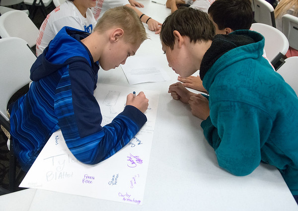 Globe/Roger Nomer<br /> David Oliphant, right, and Shane Holman, Cassville Middle School eighth graders, work on a presentation during Wednesday's Middle-Level Leadership Day at Billingsly Student Center.