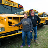 Joplin school bus aide Nerissa Maki, left and Donnie Eichelberger stand in front of a row of busses before student pick up on Thursday at the bus yard. Eichelberger has driven for the district for five years.<br /> Globe | LAurie Sisk