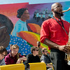 Globe/Roger Nomer<br /> Mark Knowles, a Missouri Southern senior from the Bahamas, plays a solo while performing with the MSSU Jazz Orchestra before Sunday's dedication of the East Town mural.