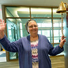 Breast cancer patient Linda Lacey, of Oronogo, waves to staff members at Mercy Hospital of Joplin as she holds the bell that patients ring after receiving their last rounds of treatments. <br /> Globe | Laurie Sisk