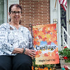 Globe/Roger Nomer<br /> Sandy Higgins poses with her Maple Leaf flag on Wednesday evening in Carthage.