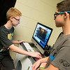 Globe/Roger Nomer<br /> Levi Stokesbary, left, and Zachary Cook, eighth graders, discuss an edit at South Middle School.