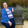 Breast cancer patient Linda Lacey, of Oronogo, sits on a bench at Mercy Hospital of Joplin's Healing Garden. The garden is a source of relaxation for patients undergoing treatment.<br /> Globe | Laurie Sisk
