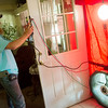 Globe/Roger Nomer<br /> David Perry, crew chief with Economic Security, demonstrates a blower door on Thursday at a house in Duenweg.