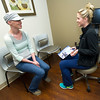 Breast cancer patient Emily Galbraith , left, visits with Freeman East Nurse Navigator Megan Carr  during a visit to Freeman East's Radiation and Oncology department.<br /> Globe | Laurie Sisk