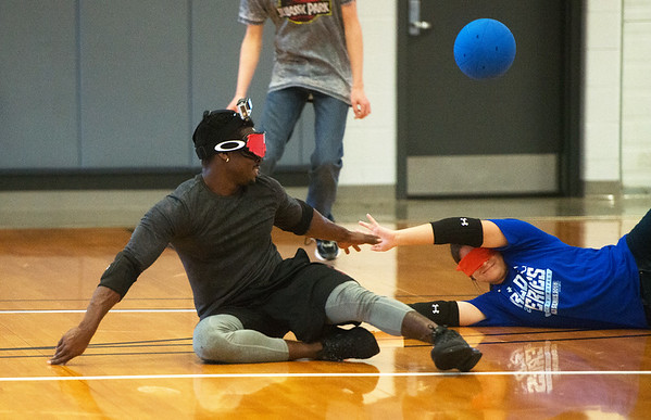 Globe/Roger Nomer<br /> Hector Arrebota, a Pittsburg State senior from Kansas City, and Kayla Light, a senior from Louisburg, try to block a ball during Goalball on Tuesday at the PSU Student Rec Center.
