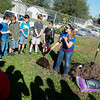 Globe/Roger Nomer<br /> Courtney Preston, consultant utility forester with ACRT, shows Jefferson Elementary third graders the parts of a tree on Monday as part of a presentation by Empire Electric at the school. To demonstrate the Right Tree Right Place campaign, Empire planted 14 trees on the school's playground. The school's goal is to build a walking trail for students that would also be available to the neighborhood on weekends.