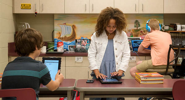 Globe/Roger Nomer<br /> (from left) Benjamin Koelkebeck, Mykela Nunnelly and Levi Stokesbary, eighth graders, work with technology on Tuesday at South Middle School.
