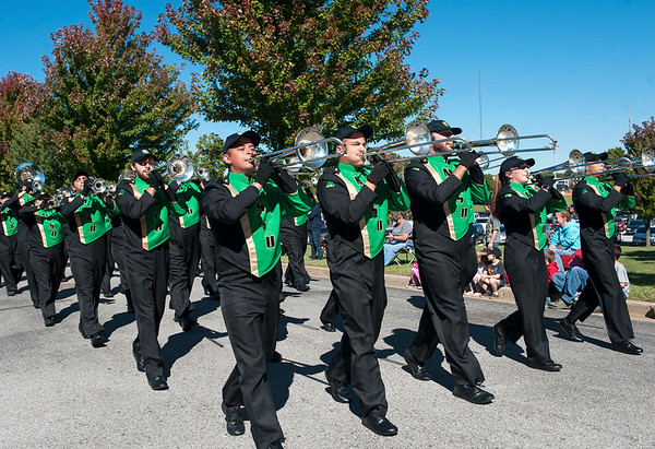Members of the Lion Pride Marching Band perform for the crowd during the Missouri Southern Homecoming Parade on Saturday at MSSU.<br /> Globe | Laurie Sisk