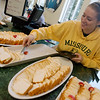 Globe/Roger Nomer<br /> Lacey Newell, a Missouri Southern junior from Gravette, Ark., serves slices of angel food cake on Monday at Billingsly Student Center. The MSSU Campus Activities board provided cakes for students on National Angel Food Cake Day.