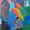 Globe/Roger Nomer<br /> Betty Smith, East Town historian, talks about the founding of East Town during Sunday's dedication. Smith is depicted above on the mural.