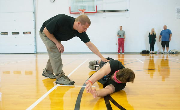 Globe/Roger Nomer<br /> Paralympian Jim Debus helps Drake McMillen, a Pittsburg State senior from Wichita, with his Goalball form on Tuesday at the PSU Student Rec Center.