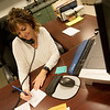 Globe/Roger Nomer<br /> Amy Graskemper works in the office at Carl Junction High School on Oct. 3.