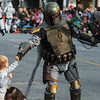 Globe/Roger Nomer<br /> Johnathan Damer, 3, Joplin, gets a fist bump from Boba Fett marching with the 501st Legion on Saturday at the Maple Leaf Parade in Carthage.