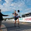 Globe/Roger Nomer<br /> Hilary Price wins the female division of the Mother Road Half Marathon on Sunday in Joplin.