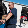 Globe/Roger Nomer<br /> Webb City firefighter Chris Burrow keeps an eye on grill during the department's Badges and Burgers fundraiser on Thursday at the Webb City Fire Department. Proceeds from the fundraiser were split between the United Way and Webb City Cares.