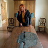 Globe/Roger Nomer<br /> Lisa Livingston-Martin talks about a table used for medical operations during the Civil War at Kendrick House in Carthage during a tour on Monday.
