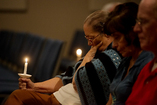 Globe/Roger Nomer<br /> (from left) Shy Rees, Julia Damiano-Moore and Jim Shapley pray for victims of the Las Vegas shootings on Monday at Fir Road Christian Church in Carl Junction.