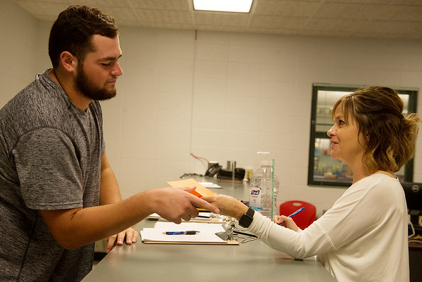 Globe/Roger Nomer<br /> Amy Graskemper gives a pass to Jordan Jones, senior, at Carl Junction High School on Oct. 3.