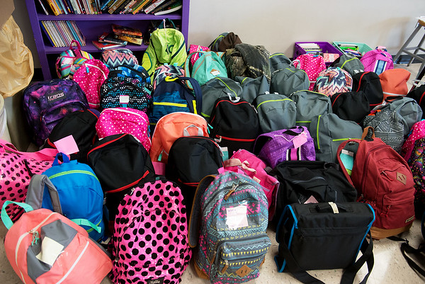 Globe/Roger Nomer<br /> Pittsburg Middle School sixth graders collected backpacks and supplies for foster children.