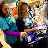 Globe/Roger Nomer<br /> Jodi Stewart, a registered nurse at Joplin High School, left, and Denisa Simpson, Joplin Schools nursing coordinator, pick up prescription drug disposal pouches during Tuesday's Opioid Crisis Summit in Southwest Missouri at Missouri Southern.