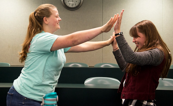 Globe/Roger Nomer<br /> Tamara Waterman, left, a Missouri Southern junior from Noel, plays a Korean game called Push Palm with Kathleen Sweeney, a junior from Orlando, Fla., on Tuesday during a demonstration of Korean games for the Korean semester at the university.