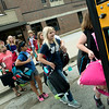 Globe/Roger Nomer<br /> Pittsburg Middle School sixth graders load backpacks onto a bus on Friday for transport to the Kansas Department for Children and Families.