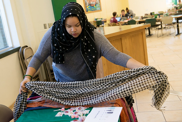 Globe/Roger Nomer<br /> Michaela Williams, a Missouri Southern sophomore from Springfield, prepares scarves for the Muslim Student Union's Hijab Day on Thursday at MSSU.