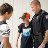 Globe/Roger Nomer<br /> John Millard, a school resources officer with the Quapaw Marshals, talks with Preston Thomasson, left, and Kevin Kohley, eighth graders at Quapaw Middle School, on Monday at the school.