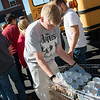 Globe/Roger Nomer<br /> Ethan Honeyball, Joplin High junior, helps unload food donations from Franklin Tech at Souls Harbor on Thursday afternoon.