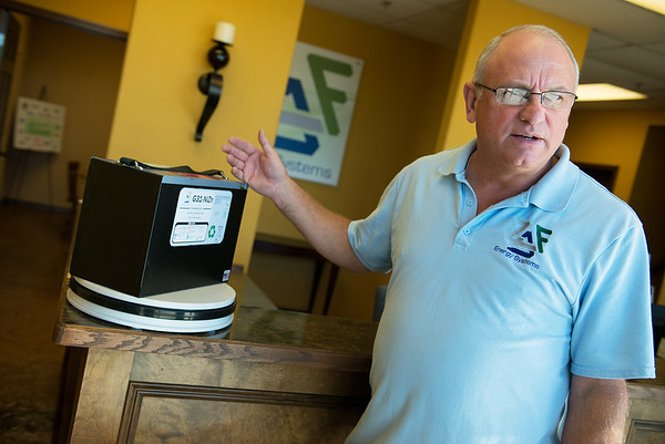 Globe/Roger Nomer<br /> Randy Moore, president and CEO of ZAF Energy Systems, talks about a battery made by the company during an interview on Monday.