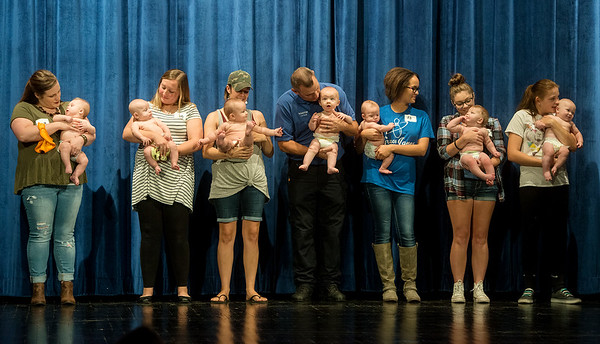 Globe/Roger Nomer<br /> Contestants and their parents line up for judging during Saturday's Maple Leaf Baby Pageant.