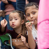Globe/Roger Nomer<br /> Sisters Paytyn Rodriguez, 5, and Jessica Tenorio, 6, try to get a good view of the Maple Leaf Parade on Saturday in Carthage.