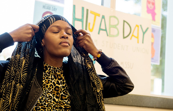 Globe/Roger Nomer<br /> Gibbeh Bah, a Missouri Southern sophomore from Gambia, puts on a hijab for the Muslim Student Union's Hijab Day on Thursday at MSSU.