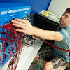 Globe/Roger Nomer<br /> William Conroy, a Crowder College senior from Webb City, works with a programmable logic control machine on Friday at the Advanced Training and Technology Center.