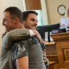 Globe/Roger Nomer<br /> Justin Cozart, left, gets a hug from Matt Ouren, court services officer, during Monday's graduation ceremony in Veterans Court at the Jasper County Courthouse.