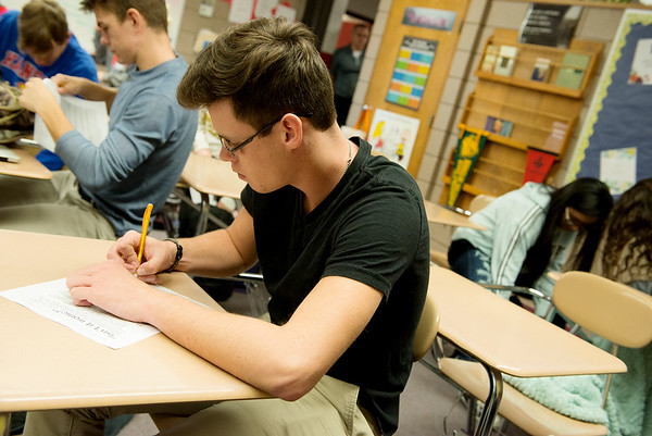 Globe/Roger Nomer<br /> Evan Duckelt, Baxter Springs High School senior, takes notes during an english class on Thursday at the school.