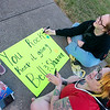 Globe/Roger Nomer<br /> Sabrina Mott-Jenkins, left, Afton, and Symba Corns, Broken Bow, Okla., cheer for runners in Galena as they make a sign for a family member on Sunday.