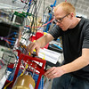 Globe/Roger Nomer<br /> Jonathan Skewes, a Crowder College student from Joplin, works with a motor control system on Friday at the Advanced Training and Technology Center.